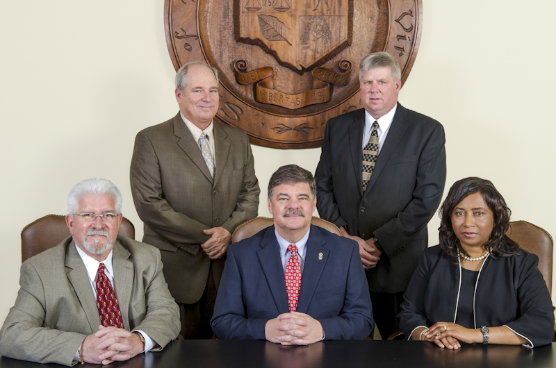 Group image of the five members of the Board of Supervisors sitting and standing