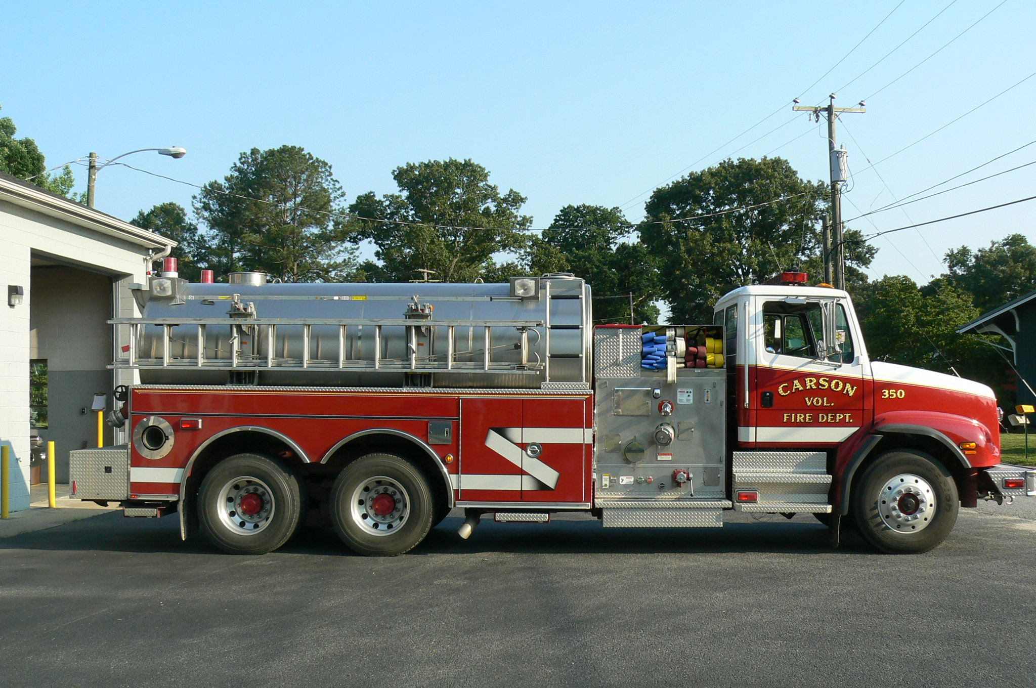Red fire tanker with ladder
