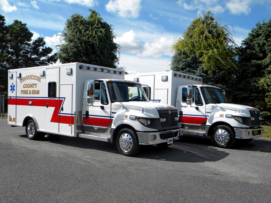 Two white and red ambulance parked side by side